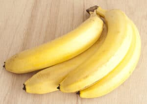 You should cut the bananas up before feeding them to your horse