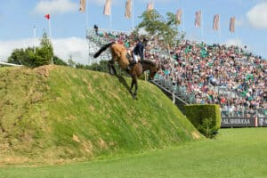The famous Hickstead Derby Bank is a great example of a cross country obstacle being used in show jumping